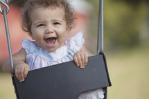 infant in a swing
