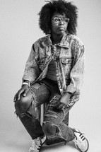 African American young woman with torn jeans and denim jacket