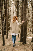a woman standing in a forest