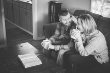 couple drinking coffee and reading a Bible