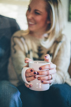 woman drinking hot cocoa
