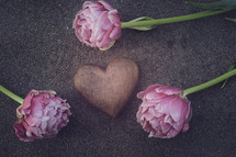 pink peonies and heart shaped stone
