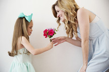 a daughter giving mother flowers.
