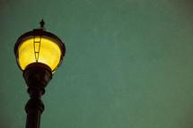 lit lamppost looking from below