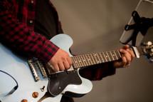man strumming a guitar