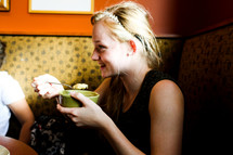 woman eating soup at a restaurant