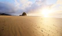 sunburst over beach sand
