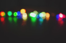 a simple row of coloured lights out of focus