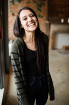 A portrait of a smiling teen girl