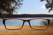 reading glasses and view of a lake