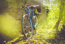 a bike leaning against a stone wall