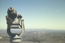 a view camera looking off into the mountainous terrain in the distance