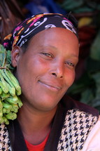 Face of a woman in an African market  [For similar search Ethnic Face Smile]
