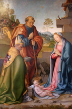 Shepherds and Kings bowing before baby Jesus