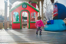 toddler looking at an outdoor Christmas display