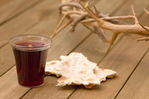 crown of thorns, communion bread and wine cup