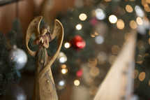 Christmas angel with bokeh background.