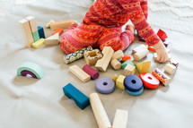 toddler girl playing with building blocks