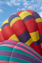 Close up shot of two colorful hot air balloons