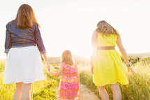 mother and daughters walking together
