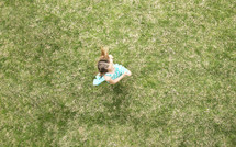 little girl running in grass.