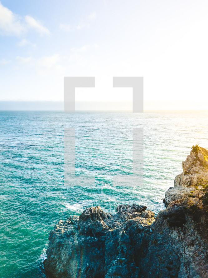 rocky cliff meets the ocean