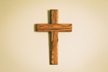 simple wood cross hanging on a wall