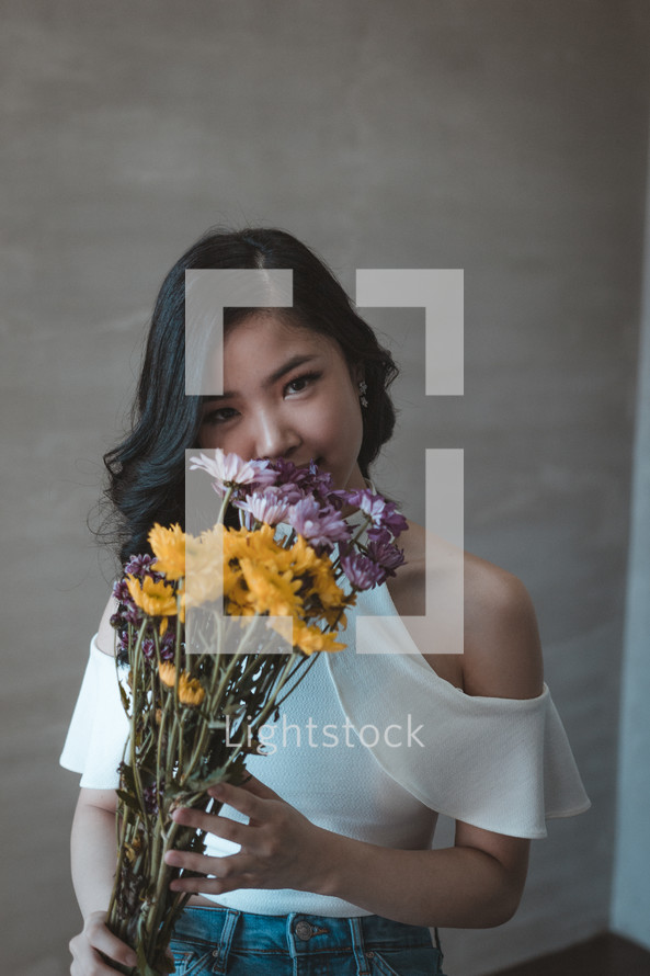 a young woman holding flowers