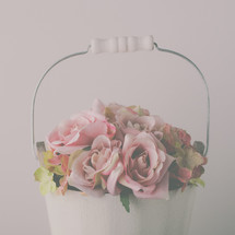 pink roses in a white pail