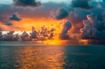vibrant orange sky over the ocean at sunset