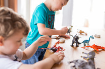 kids playing with toy dinosaurs