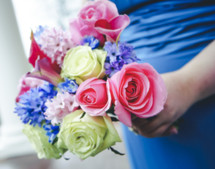 Bridesmaid holding bouquet of flowers