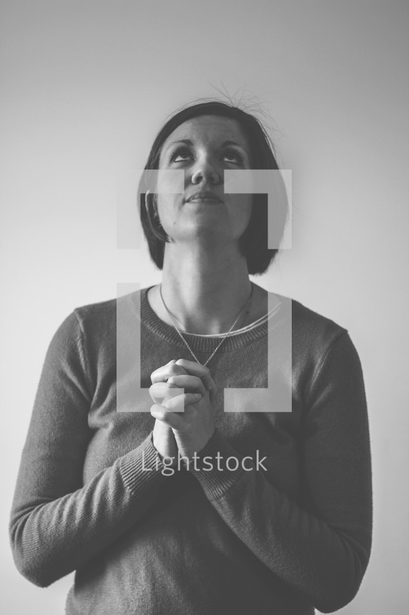 woman looking up to God in prayer