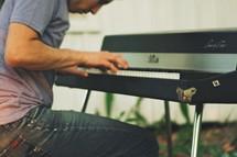 A man playing a keyboard.