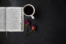 open Bible, dried roses, and coffee cup