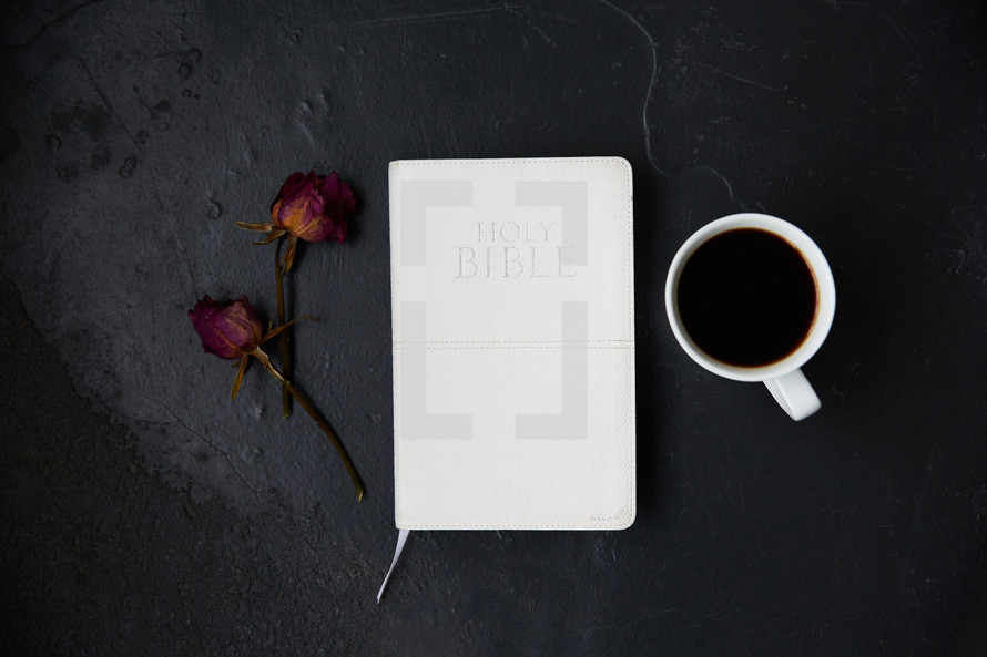 dried roses, Bible, and coffee cup