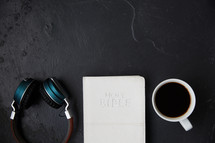 headphones, Bible, and coffee cup