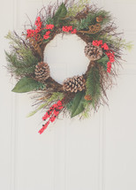 a Christmas wreath hanging on a door