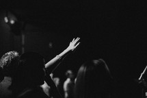 raised hands in an audience