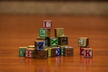 pile of wood blocks on a playroom floor