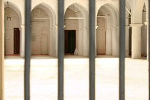 doors of a mosque through a fence