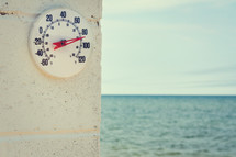 outdoor thermometer at the beach