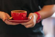 man holding a coffee mug and saucer