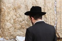 A man praying at the Western wall
