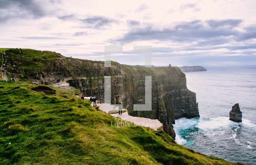 standing at the edge cliffs along a coastline