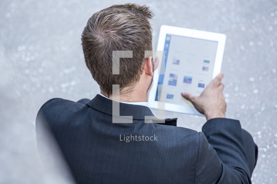 businessman looking at an iPad screen