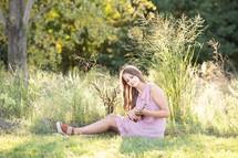 teen girl playing a ukulele