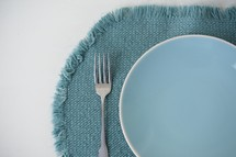 blue plate and placemat