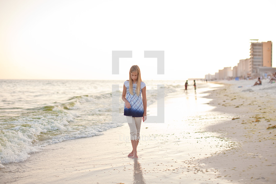 girl walking on a beach