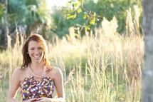 brunette teen in a field